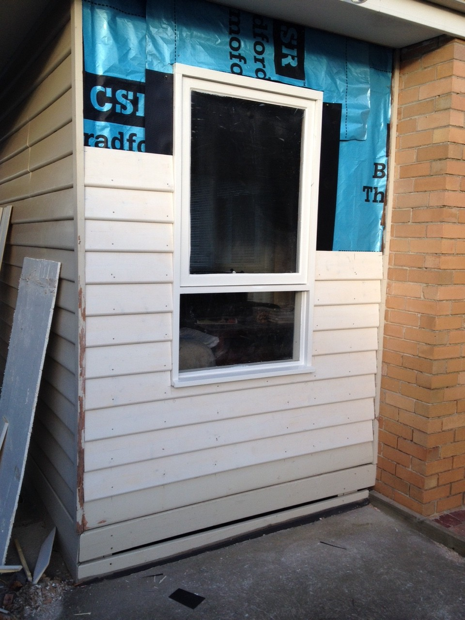 Installation And Painting Of A Timber Window And Weather